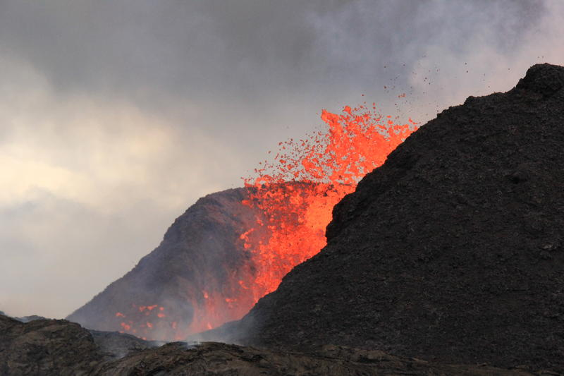 The spatter cone at fissure 8 is now about 55 m (180 ft) tall. Lava fountains rise only occasionally above that point, sending a shower of tephra (cooled lava fragments) over the rim.