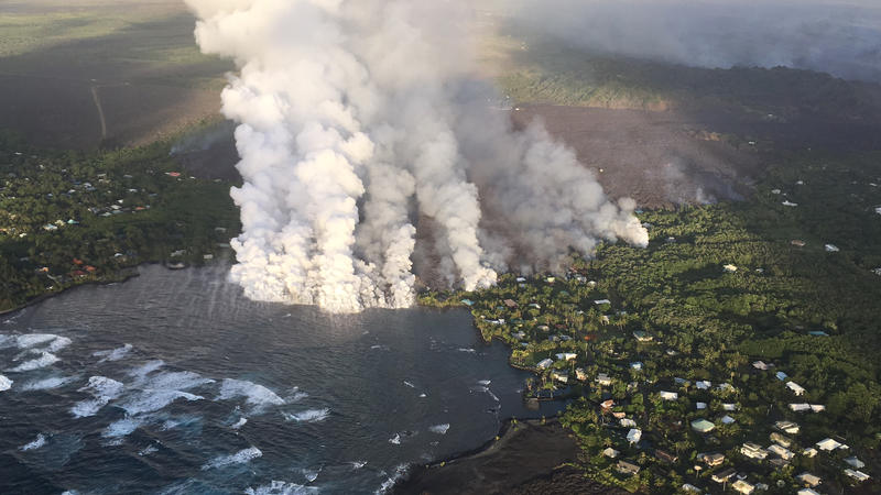 Overflight photograph at approximately 6:13 a.m. HST shows the lava flow originating from Fissure 8 (not visible in photograph) entering Kapoho Bay. The ocean entry was reported to have occurred by 10:30 p.m. on the night of June 3, 2018.