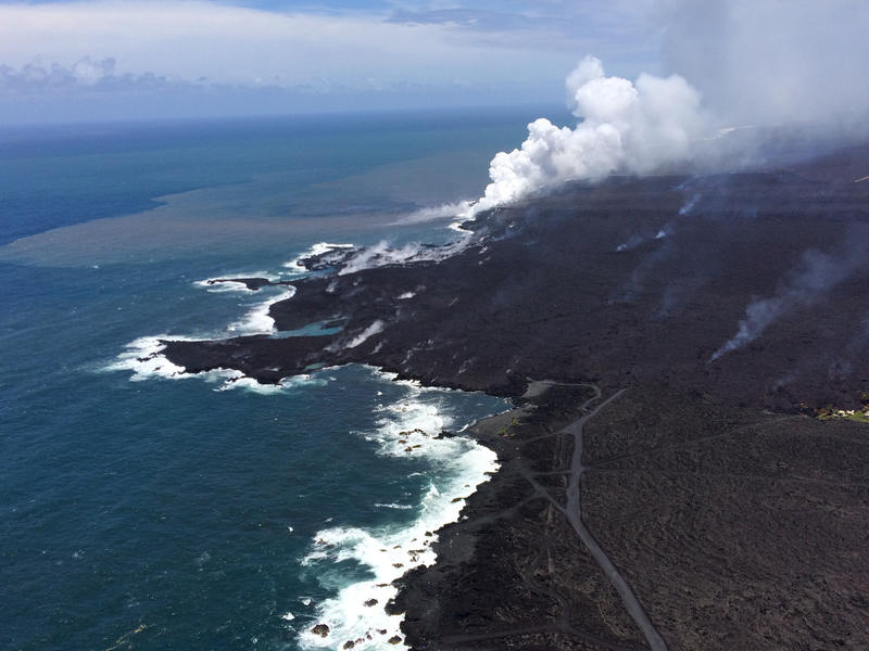 Lava has filled Kapoho Bay, building a new lava delta that is now about 250 acres in size. This aerial view of the ocean entry looks to the southwest.