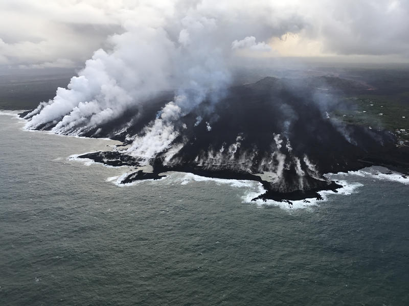Aerial view of the ocean entry at Kapoho, where a lava delta about 250 acres in size is filling the bay. USGS image taken June 12, 2018, around 6:50 a.m. HST.