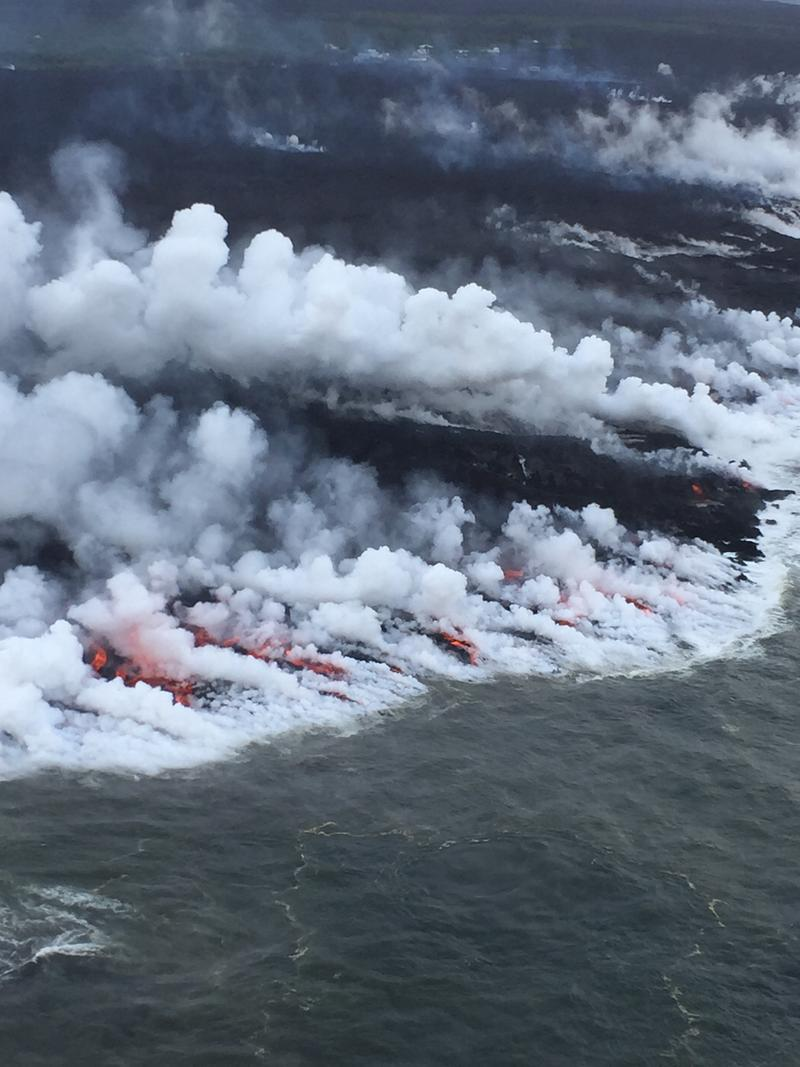 The south side of the ocean entry was most active today, with many small streams of lava and corresponding steam plumes spread along a fairly broad section of the southern part of the delta.