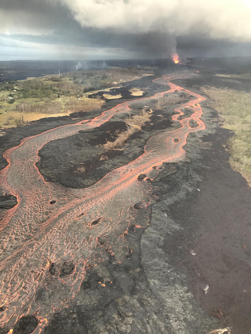 Fissure 8 (fountain visible in distance) feeds lava into an active braided channel that flows about 8 miles (north, then east) to the ocean entry in Kapoho Bay.
