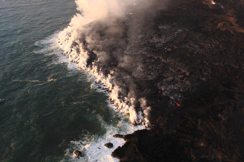 Lava was entering the ocean over a broad area this morning. This image shows an active entry area along the northern flow front at Kapoho. View to the south.