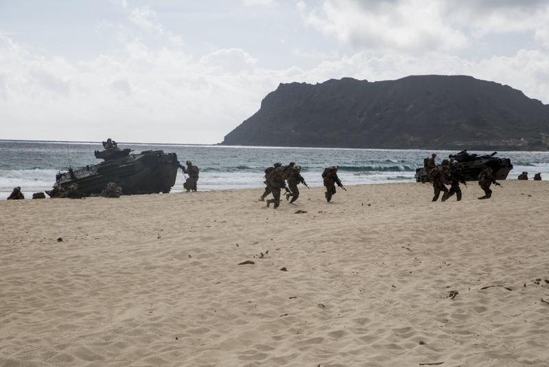 U.S. Marines disembark from assault amphibious vehicles, or AAV's, on Pyramid Rock Beach.