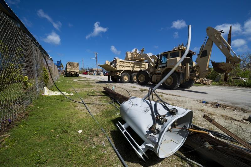 Military vehicles were used to clear downed power lines and other debris from roads on Saipan.