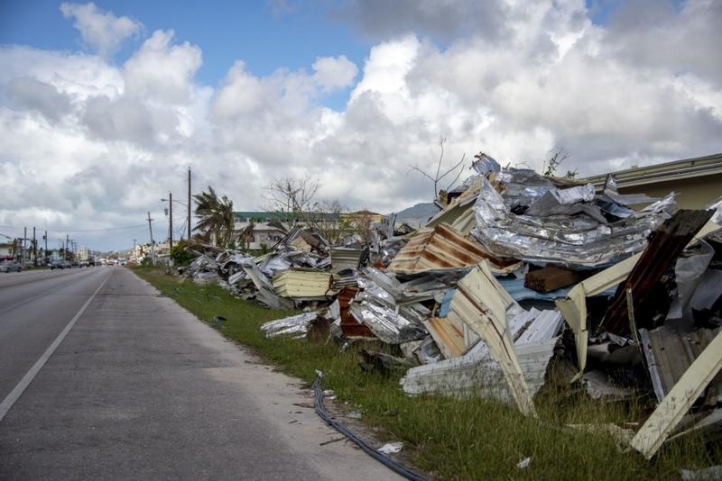 Cleared debris lines the roads of Saipan.