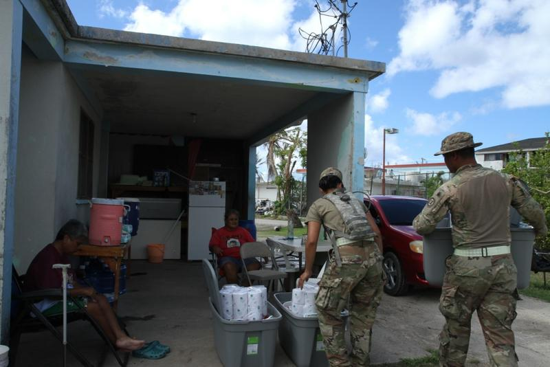 US Army Reserve soldiers deliver supplies to residents of Oleai village in Saipan.