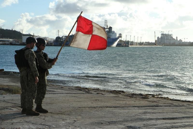 U.S. Navy sailors guide a landing craft into port in Saipan.