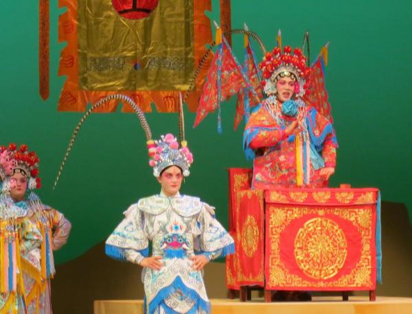 """Sami L.A. Akuna plays Mu Giuying and Amanda Stone plays her son Yang Wenguang in this scene from """"Lady Mu and the Yang Family Generals"""" playing at Kennedy Theatre Feb 2 - Mar 2."""