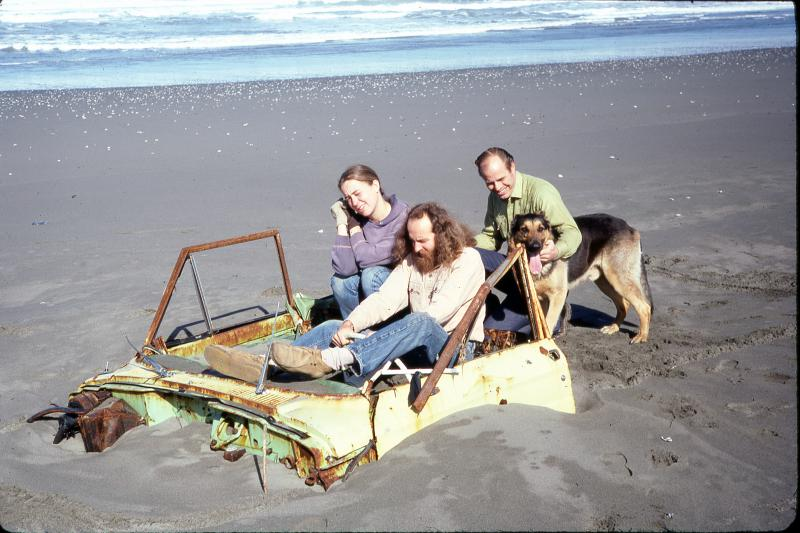 """Greg Abbott and others """"drive"""" a truck buried in the beach in Manila, CA."""