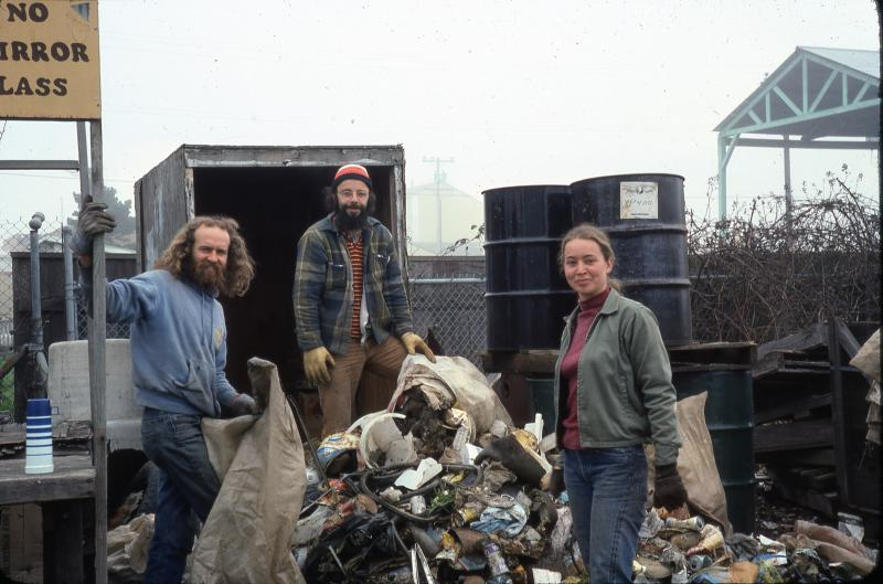 Greg Abbott, Sid Dominitz and an unidentified woman dumping trash pulled from beaches in 1977.