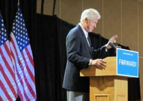 Former President Bill Clinton speaks to supporters at a rally in Council Bluffs Wednesday morning for President Obama.