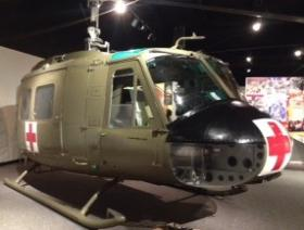 A restored 1966 Huey helicopter is part of the 1968 exhibit at the Durham Museum.