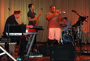 Cique features(L-R) the noted pianist Jeff Jenkins with Bijou Barbosa on electric bass, trumpeter/educator Darryl White, and Brandon Draper on drums.