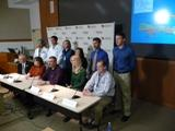 Members of a 12-member medical team going to Haiti speak during a news conference Friday at UNMC.
