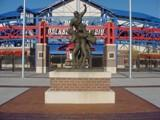 The Road to Omaha statue at the entrance of Rosenblatt Stadium celebrates the landmark's distinction as the home of the College World Series.
