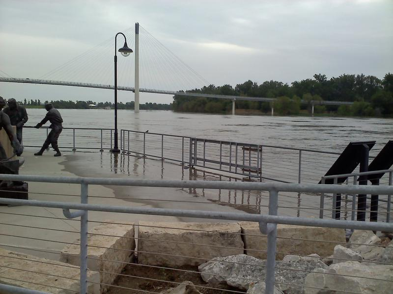 Water rises on to the platform of the labor statue on the Omaha riverfront.