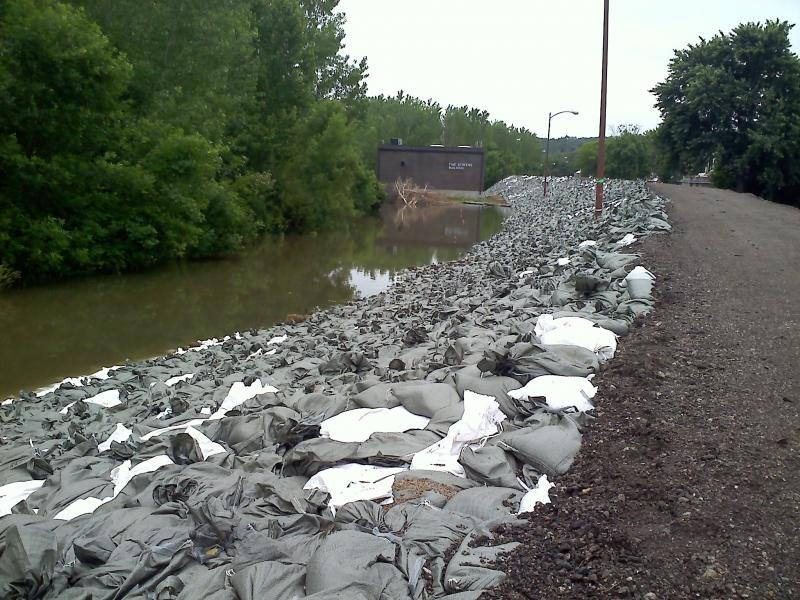 Sandbags sit atop an earthen berm protecting Omaha's Waste Water Treatment Plant.
