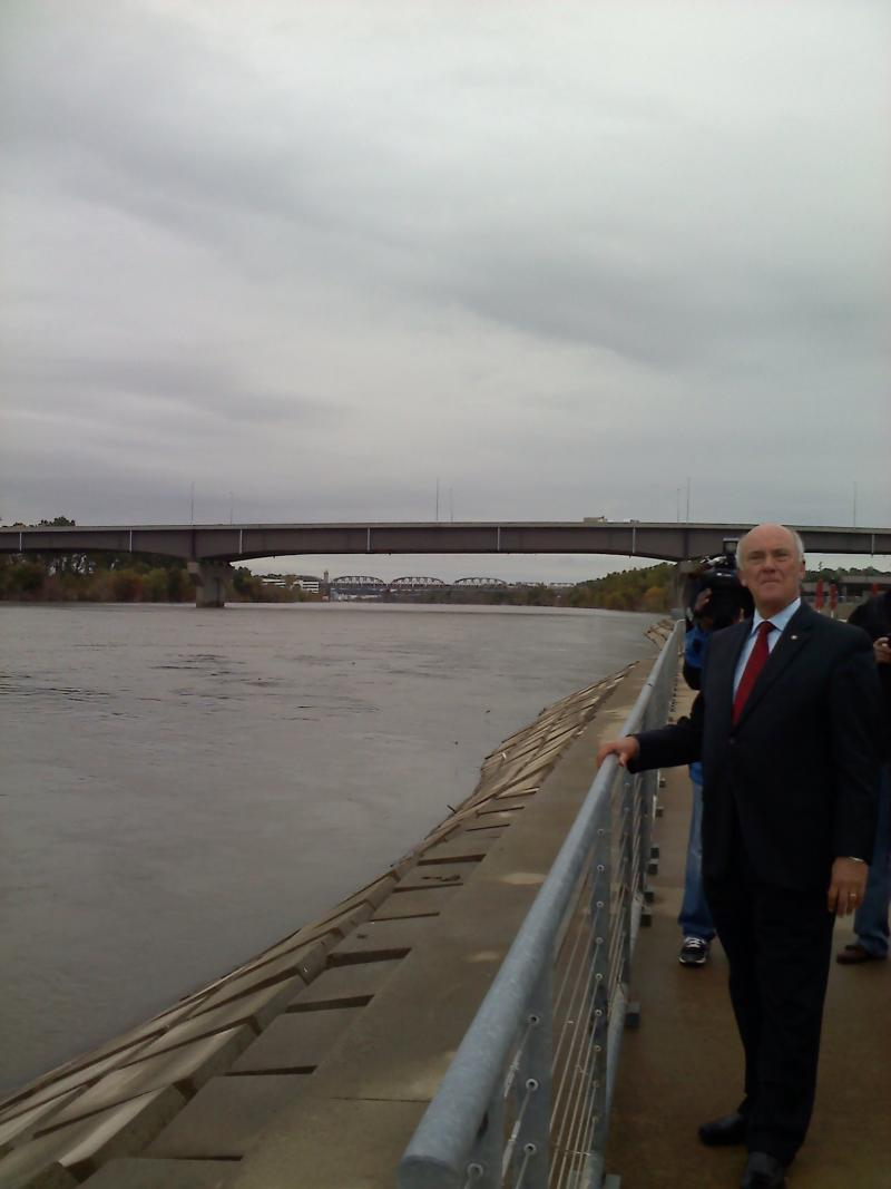 Omaha Mayor Jim Suttle looks out at the Missouri River after the Lewis and Clark Landing re-opened Friday morning.