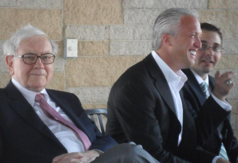 Berkshire Hathaway CEO Warren Buffett, new Omaha Storm Chasers owner Gary Green, and Storm Chasers GM and VP Martie Cordaro at Tuesday's news conference.