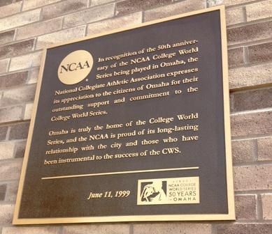 A plaque outside TD Ameritrade Park commemorates the 50th anniversary of the CWS, in 1999.