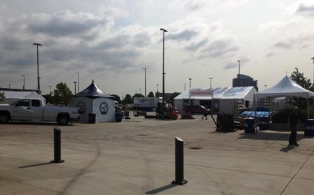 Workers set up the Fan Zone area outside Gate 3 of TD Ameritrade Park.