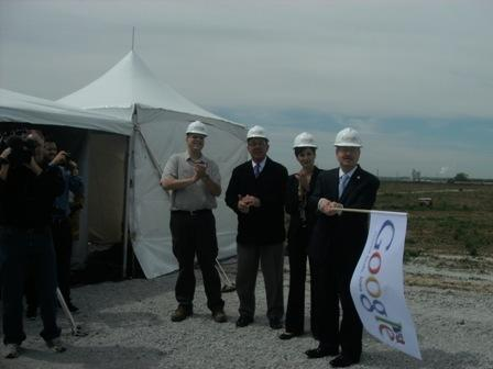 Officials prepare to 'wave the flag' to start construction on the new data center.