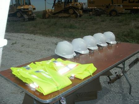 Hard hats and vests are prepared for the data center groundbreaking.