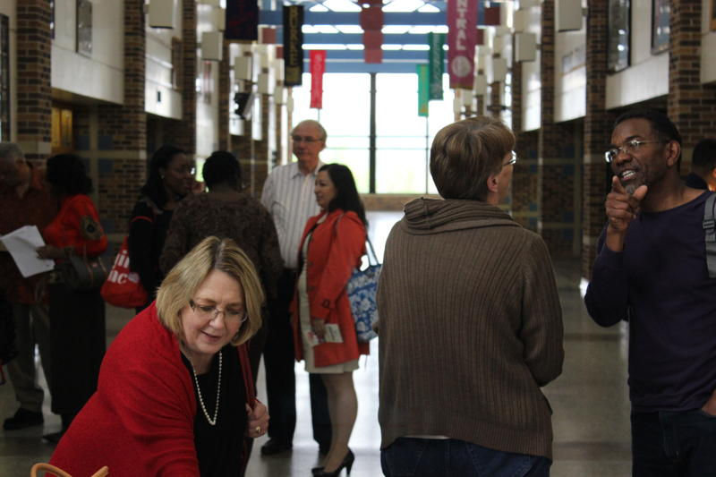 Voters gather to caucus at Omaha North High School.
