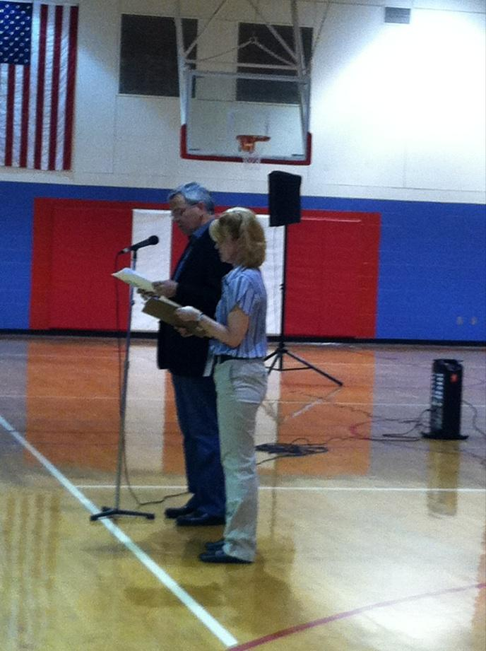 Sen. Steve Lathrop, the LD 12 caucus chair, speaks to voters at Ralston Middle School.