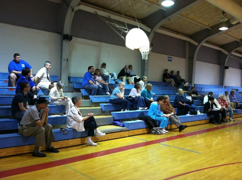 Voters caucus at Ralston Middle School.