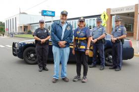 Two OSP Volunteers from Lincoln City – Sheridan Jones and Cindy Dorrell – pose with Oregon State Police from the North Area Command, Senior Trooper Carla Urbigkeit, back left, Senior Trooper Bryan Fitch and Lt. Justin McGladrey, back right.