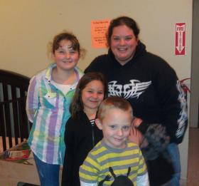Jennifer Brown and her four children (one of the twin boys is hiding) at First Place Family Center in Eugene.