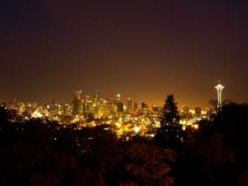 Urban sky glow is evident in the night sky over Seattle.