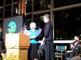 Eugene Mayor Kitty Piercy awards Community Service Award to Occupy Medical at the 2014 State of the City event.