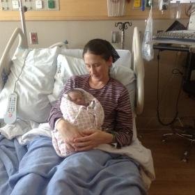 Miriam Baer holds her newborn Emma Grace born on New Year's Day in Springfield, Ore.