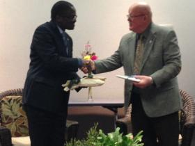 His Excellency, Ambassador Mulonda and Cottage Grove Mayor Thomas Munroe exchange gifts to each other