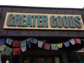 Greater Goods sign with prayer flags.