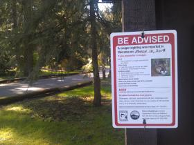 A sign posted at Hendrick's Park in Eugene warns of the cougar recently seen in the area.
