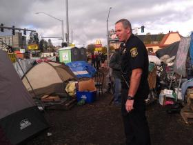 EPD Lt. Doug Mozan walks through Whoville site while people pack up.