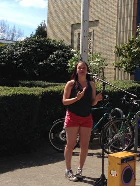 Kelsey Juliana speaks Tuesday in front of the Eugene post office.