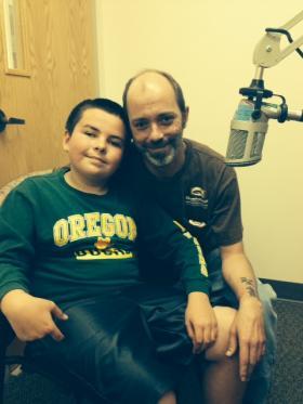 Ten year old Keegan Keppner and his step dad Steve Magray in the KLCC studios.