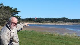 Port of Coos Bay's chief commercial officer Martin Callery points out the site of the proposed Jordan Cove export terminal for liquefied natural gas.
