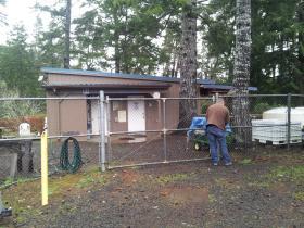 ODFW Biologist John Spangler enters the small Munsel Creek Hatchery.