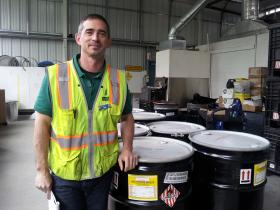 Chad Ficek, Special Waste Analyst for Lane County, stand by drums full of cellulose nitrate negatives.
