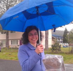 Dawn Lesley canvassing in Veneta on a rainy Saturday.