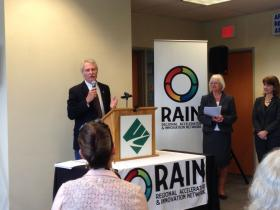 Governor John Kitzhaber pledges support to the RAIN project at the Eugene Chamber of Commerce. Mayors Kitty Piercy (Eugene) and Julie Manning (Corvallis) are at right.