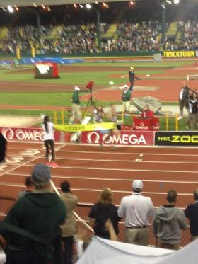 Galen Rupp breaks the tape at the end of Friday's 10K race.