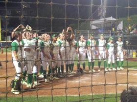 Oregon's softball team celebrate after Super Regional win.