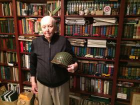World War II veteran Art Sorenson holds the helmet he wore in battle.